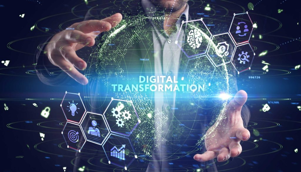 Man holding hologram that reads Digital Transformation