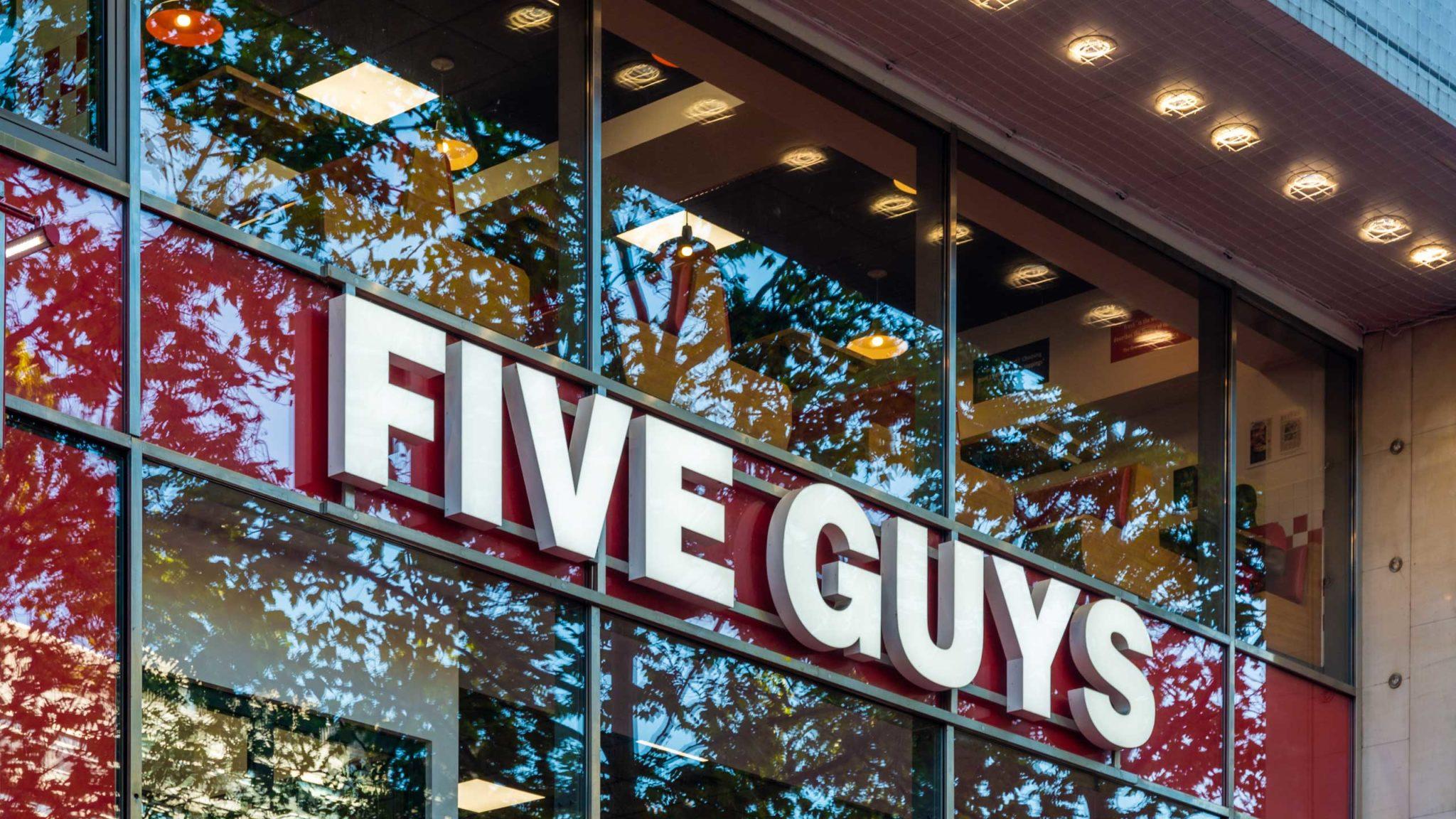 Five Guys signage on restaurant window