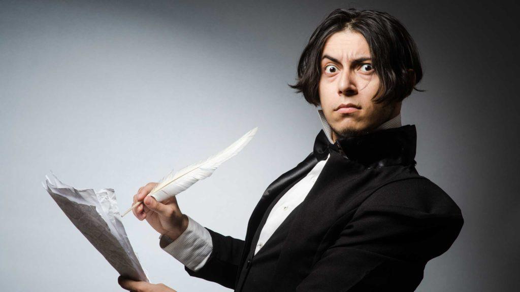 Man using quill and paper to create marketing plan