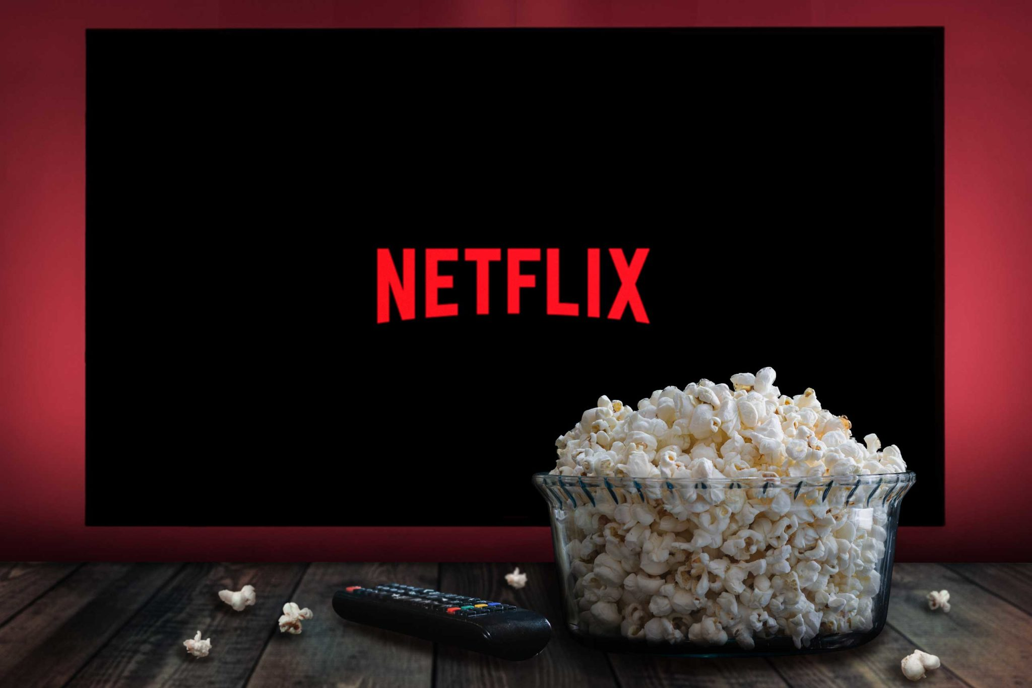 Bowl of popcorn in front of TV screen showing Netflix logo