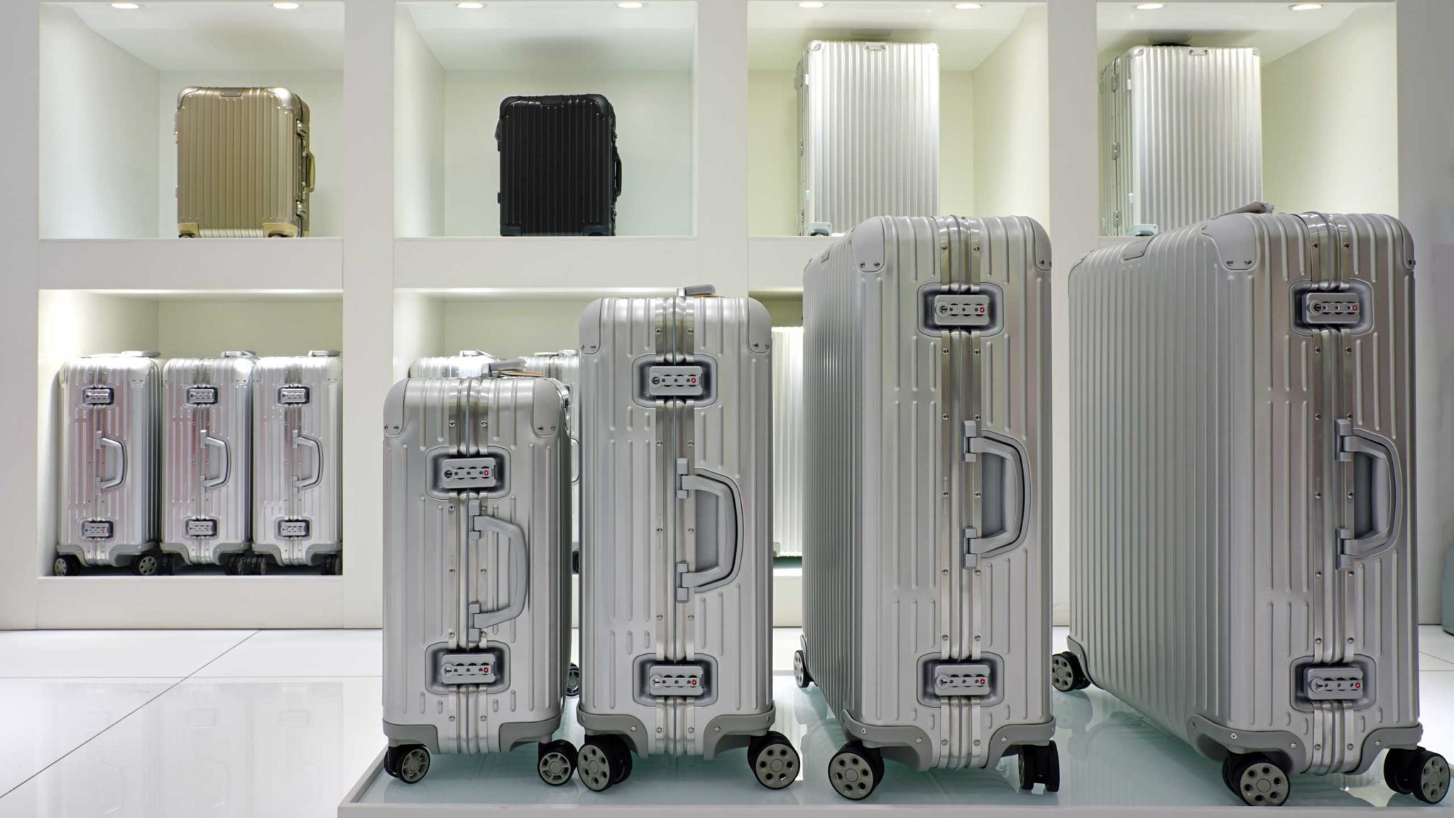 Silver Rimowa suitcases in a shop